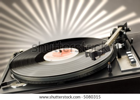 close up shot of gramophone player with backlight - stock photo