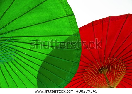 Close up shot of green and red Lanna umbrellas. - stock photo