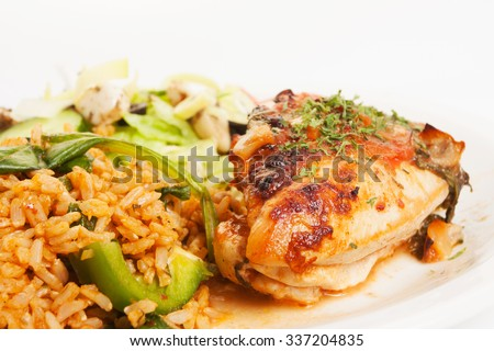 Close up shot of grilled chicken on a plate with rice and salad. Shot on white background - stock photo