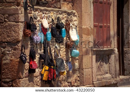 close up shot of handmade bags on the wall - stock photo