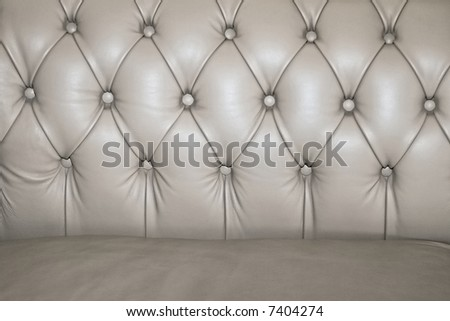 Close up shot of leather sofa buttons - stock photo