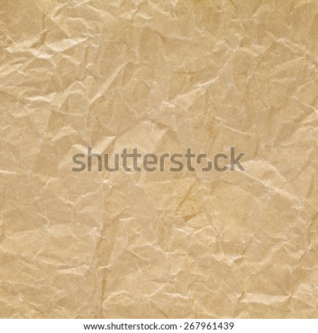 close up shot of light brown crumpled recycled paper texture background - stock photo
