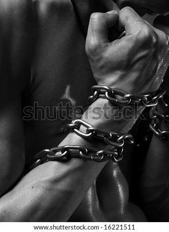 Close-up shot of male hand wound by chain - stock photo