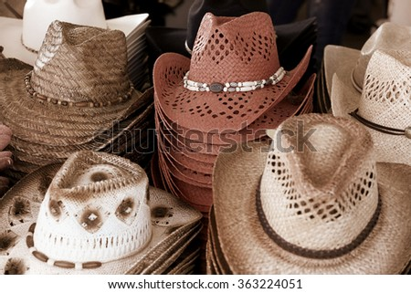 Close up shot of many cowboy hats - stock photo