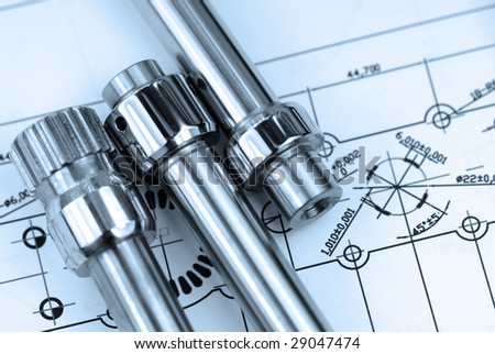 close up shot of mechanical part on  Engineering drawing - stock photo