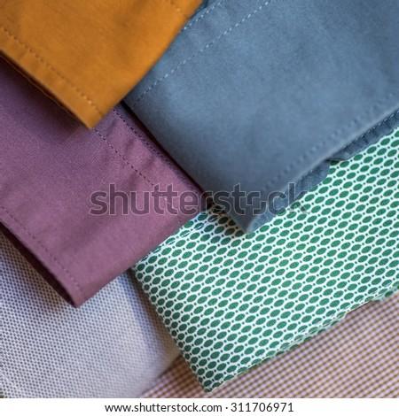Close-up shot of men's shirt sleeves - stock photo