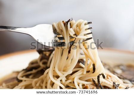 close up shot of mushroom spaghetti - stock photo