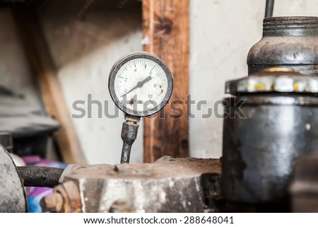 Close up shot of old air compressor - stock photo