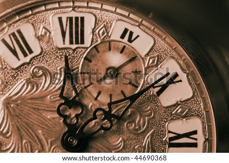 Close up shot of old Sepia toned Time Piece - stock photo