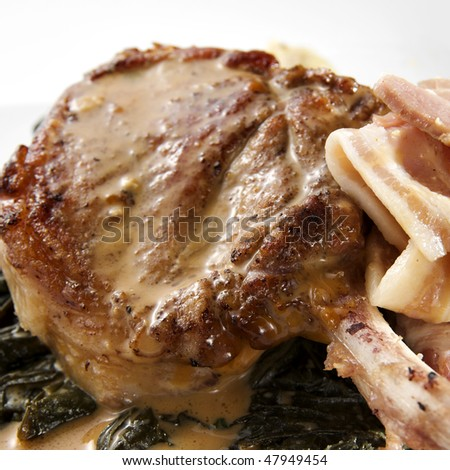 close up shot of pan fried pork cutlet with calvados
