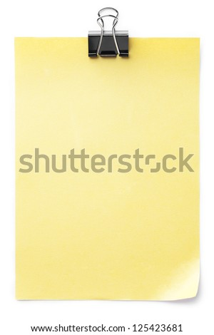 Close-up shot of paperclip on blank yellow note. - stock photo