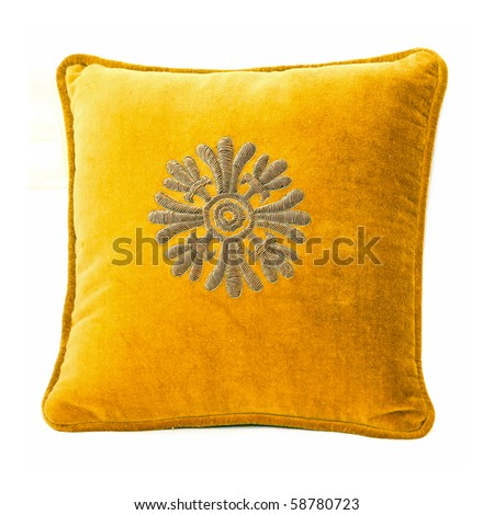 Close up shot of plush pillow with ornament - stock photo