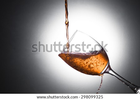 Close-up shot of pouring wine in wine glass - stock photo