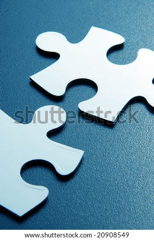 Close up shot of puzzle pieces - stock photo