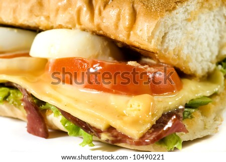 Close-up shot of questionably delicious looking bacon sandwich