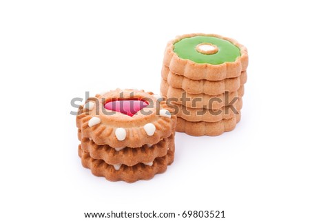 close up shot of red and green cookies isolated on white