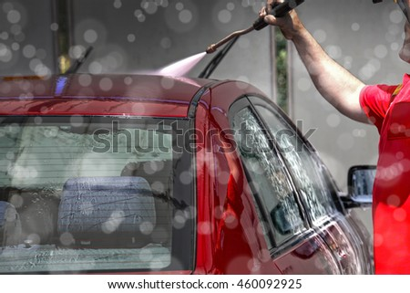 close up shot of red car being washed with pressure washer. - stock photo