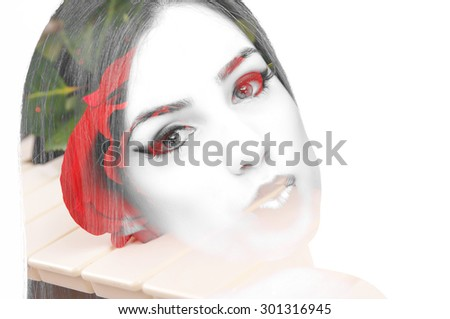 Close-up shot of red rose on the piano keyboard - stock photo