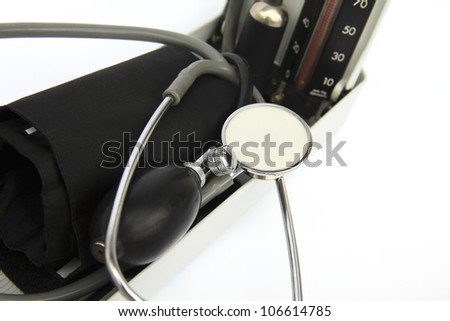 close up shot of retro sphygmomanometer and stethoscope - stock photo