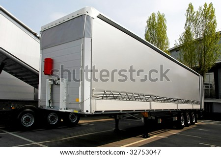 Close up shot of silver lorry trailer