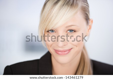 Close up shot of smiling young businesswoman isolated on
