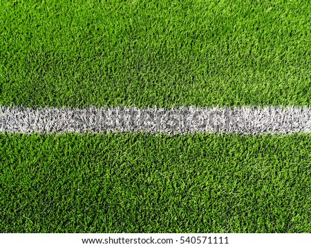 close up shot of soccer field, sideline, made from synthetic lawn,selective focus