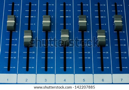 close up shot of sound mixer in studio - stock photo