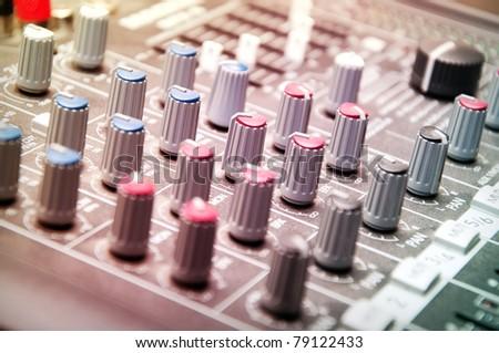 close up shot of sound mixer in studio - stock photo