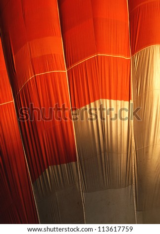 Close up shot of the canvas of a red and yellow hot air balloon - stock photo