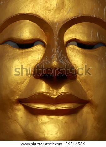 Close up shot of the smile Buddha's face - stock photo