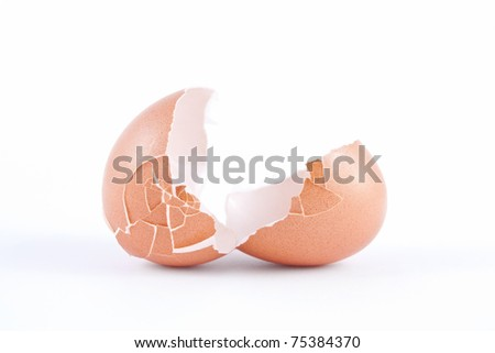Close up shot of the two halves (eggshells) of a broken, empty egg. - stock photo