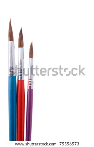 close up shot of three multicolored paintbrushes isolated on white