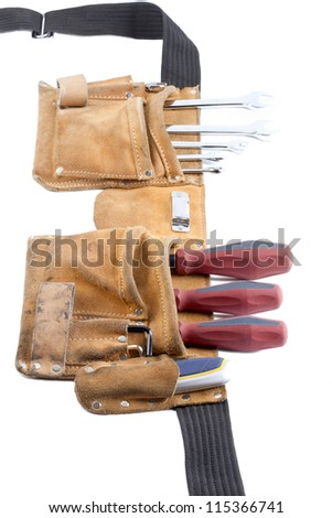 Close-up shot of tool belt with screwdriver and spanner on white background. - stock photo