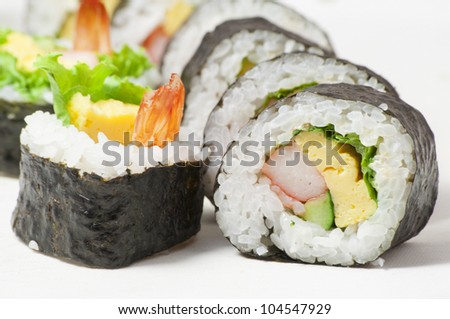 close-up shot of traditional fresh japanese sushi rolls, focus on the front piece - stock photo