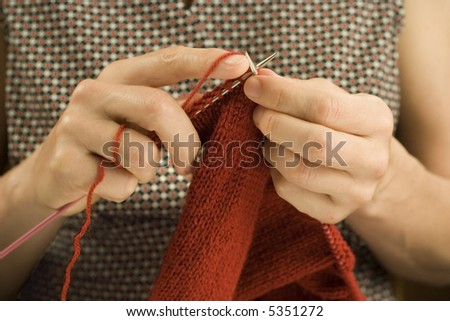 Close up shot of two hands knitting - stock photo