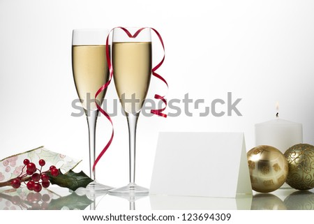 Close-up shot of two wine glass along with other ornaments. - stock photo