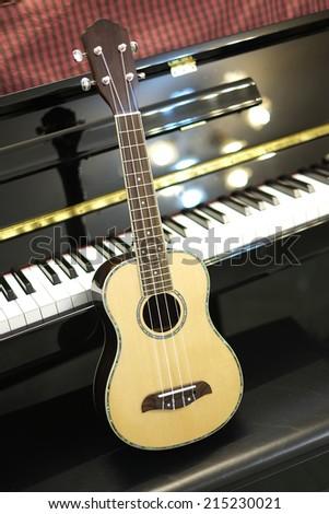 close up shot of Ukulele and piano - stock photo