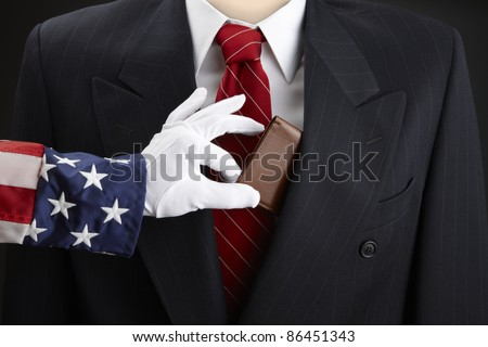 Close up shot of Uncle Sam picking the pocket of a businessman - stock photo