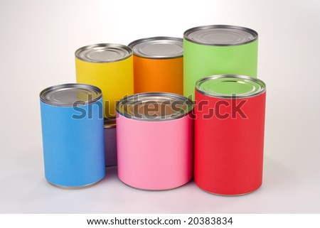 Close up shot of various tin cans with plain colored labels