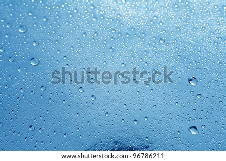close up shot of water droplets on windows - stock photo