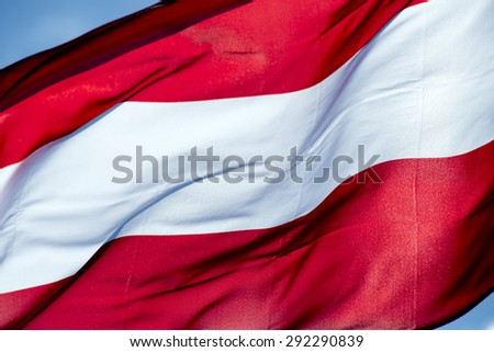 Close up shot of wavy flag of Austria - stock photo