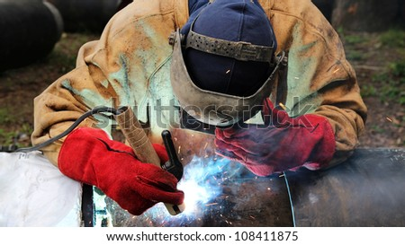 Close up shot of welding and sparks. Selective focus. - stock photo