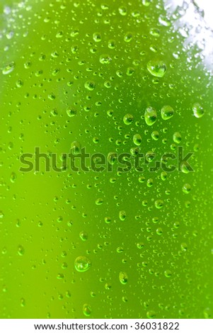 Close up shot of wet bottle with tropical drink - stock photo