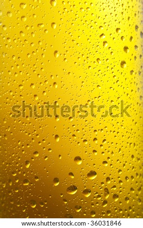 Close up shot of wet bottle with water drops - stock photo