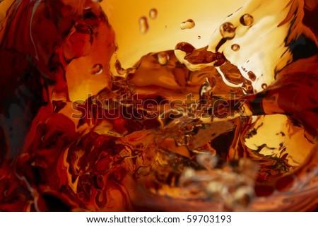 Close up shot of whiskey splashing in glass - stock photo