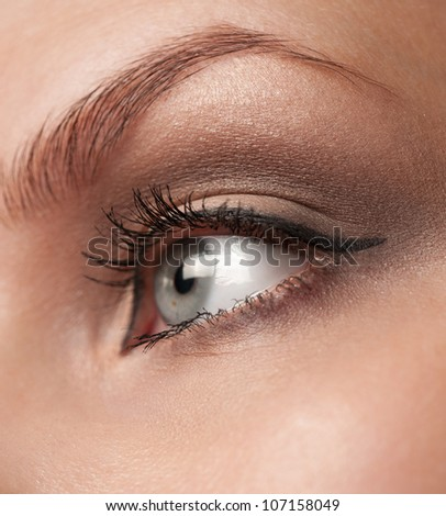 Close-up shot of woman eye with makeup looking away - stock photo