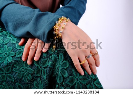 Close up shot of women hand with gold bracelet, ring, jewelry