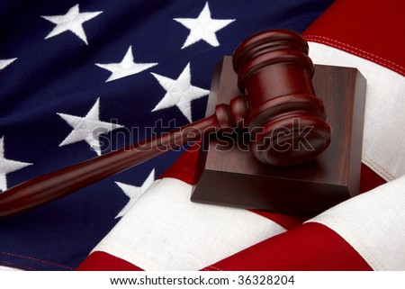Close up shot of wooden gavel shot on American flag - stock photo