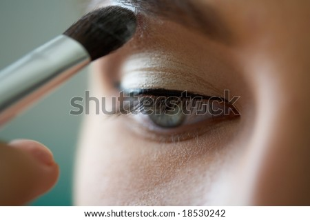 Close-up shot of work of make-up specialist. Low-focus image. - stock photo