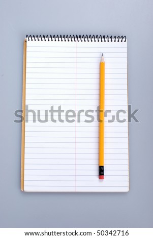 close-up shot of yellow pencils on notebook - stock photo
